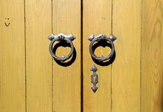 Wooden door background. Metal round handle on an wooden door royalty free stock photos