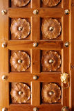 Wooden Door with Beautiful Carving Designs Stock Photography