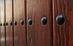 Wooden door with black iron rivets Royalty Free Stock Image