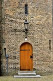 Wooden door in a brick medieval turret royalty free stock images