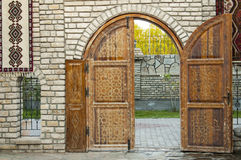Wooden door. On brick wall Stock Image