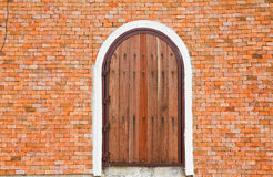 Wooden door on a brick wall. Royalty Free Stock Photo