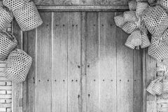 Wooden door and brick wall background with basket weave wood. Royalty Free Stock Photos