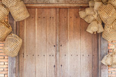 Wooden door and brick wall background with basket weave wood. Stock Photo