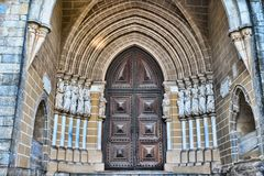 Wooden door on brick wall church in Evora Portugal Stock Images