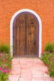 Wooden door on brick wall Stock Photos