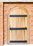 Wooden door and brick wall. Stock Photo