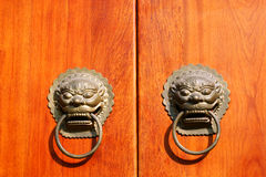 the wooden door with bronze lion-shaped knockers Royalty Free Stock Image