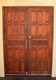 Wooden door. Brown wooden door with carvings Royalty Free Stock Photo