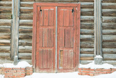 Wooden door brown color in an old abandoned country house of logs Stock Photography