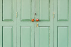 Wooden door with brown knobs Stock Image