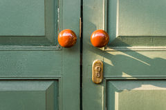 Wooden door with brown knobs Royalty Free Stock Photos