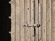 Wooden door brown mud covered stock image
