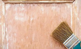Wooden door and brush Royalty Free Stock Photos