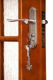 Wooden door with a bunch of keys Stock Image