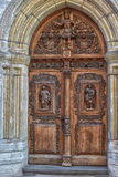 Wooden door with carved figures. Tallinn, Estonia Royalty Free Stock Photos