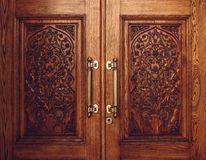 Wooden Door Carved with Floral Ornament. Royalty Free Stock Image