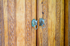 Wooden door with carving Stock Photography