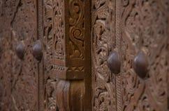 Wooden door carvings. Brown wooden door with traditional carvings in the city of Khiva, Uzbekistan Stock Images