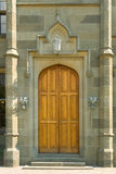 Wooden door in castle Stock Images