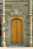 Wooden door in castle Stock Images