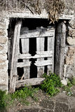 Wooden door of a cellar in the country, Italy. Calcata is a town in the Province of Viterbo in the Italian region Latium Royalty Free Stock Images
