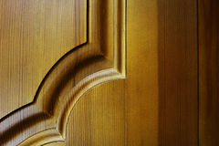 Wooden door collected from different boards stained pine. Royalty Free Stock Photography