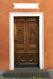 Wooden door in colorful wall Royalty Free Stock Photography