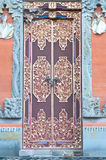 Wooden door of country house with carved ornament Royalty Free Stock Photo