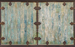 wooden door with cracked color paint for background Royalty Free Stock Images