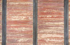 wooden door with cracked color paint for background Royalty Free Stock Image