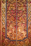 Wooden door decorated with carvings Royalty Free Stock Photo