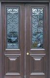 Wooden door with decorative windows Stock Photography