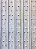 Wooden door details. Abstract pattern of wooden door with vertical lines and dots Royalty Free Stock Photo