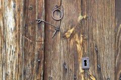 Wooden door. Details of the closure of a wooden door of a village in Spain Royalty Free Stock Image