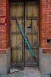 The wooden door of dilapidated building in a city Royalty Free Stock Image