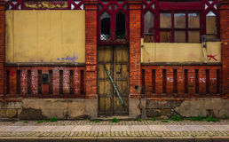 The wooden door of dilapidated building in a city Stock Photos