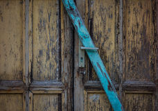 The wooden door of dilapidated building in a city Royalty Free Stock Photos