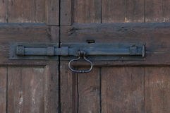Wooden door with doorhandle and keyhole Royalty Free Stock Photo