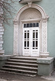 Wooden door entrance to the building in classical style. Stock Image