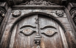 Wooden door with eyes Royalty Free Stock Photography