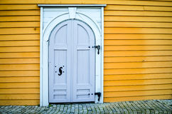 Wooden door of a facade in bryggen, bergen Stock Photography