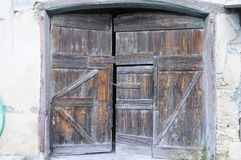 Wooden door of a farm in France Stock Photography