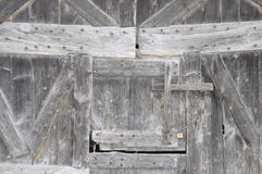 Wooden door on farm wall in France Royalty Free Stock Photos