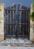 Wooden door in the fence. Old nice wooden door in the fence royalty free stock image