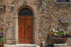 Wooden door in old Italian house, Tuscany, Italy royalty free stock images