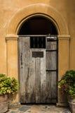 Wooden door  in the garden.  Royalty Free Stock Photography