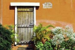 Wooden door and garden Royalty Free Stock Photos