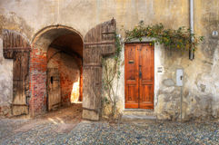 Wooden door and gate in brick house. Royalty Free Stock Images