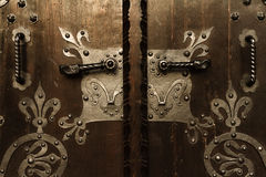 Wooden door gate with metal ornamentals. Royalty Free Stock Photography